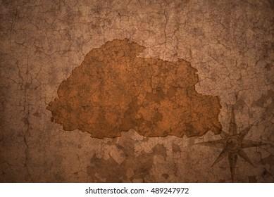 bhutan map on a old vintage crack paper background