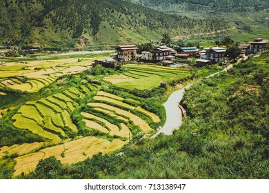 Bhutan, Punakha, panoramic view of valley from Lobesa towards Wangdue Phodrang. Rice crops between the rivers Pho Chhu and Mo Chhu.