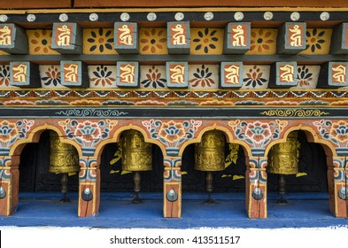 Bhutanese buddism praying wheels at Chimi Lhakang Monastery, Punakha, Bhutan - Chimi Lhakhang, also known as Chime Lhakhang or Monastery or temple, is a Buddhist monastery in Punakha District, Bhutan.