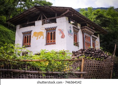 Bhutanese house with traditional phallus paintings near Punakha, Bhutan. Symbol brings good luck and drives away evil spirits.