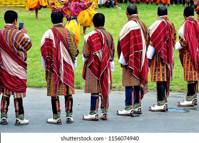 Bhutanese men in their best traditional attire. Bhutanese are fond of their unique dress which they proudly wear at all times. Shown in the picture is Bhutanese clergy men in their formal dress.