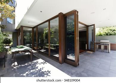 Bi fold doors opening to rear courtyard of contemporary Australian home