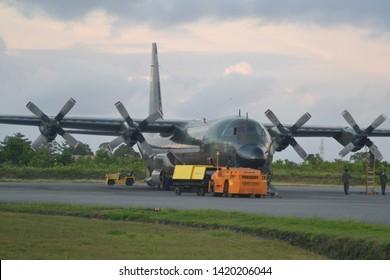 BIAK, PAPUA - JUN 9, 2019the atmosphere of a manahua military air base in the morning, prepares to transport military and civilian passengers. Indonesian air force c130 aircraft help transport people