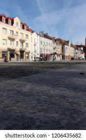 Bialystok, Podlasie, Podlaskie Voivodeship, Poland, citycenter in spring. Close up view from a puddle level on the sidewalk