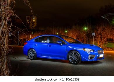 BIALYSTOK, POLAND - 11.20.2018: Night photoshoot of blue subaru wrx in front of the Podlasie Opera and Philharmonic—European Art Centre in Białystok