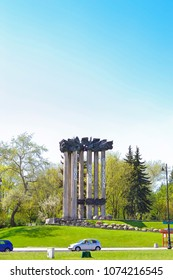 Bialystok, Poland - April 30, 2012: Memorial Bog Honor Ojczyzna in the historical center of Bialystok, Poland. Sculptural group God, Honor, Homeland in the spring Park among the green trees
