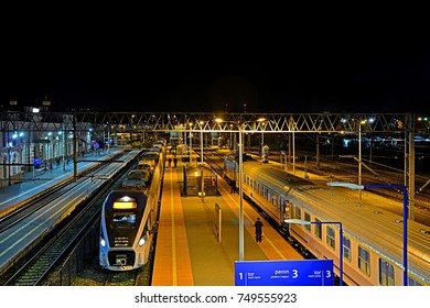 BIALYSTOK, POLAND - OCTOBER 20 - Night view of Bialystok railway station with Pesa Dart ED161 and carriage long-distance PKP Intercity trains on October 20, 2017 in Bialystok, Poland