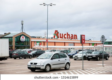 Bialystok/Poland February 12, 2019  View of Auchan supermarket logo, entrance and parking.Auchan is a French international supermarket chain, is one of the largest distribution groups.