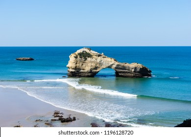 Biarritz beach at low tide with waves. Basque country of France.