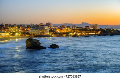 Biarritz city in the Bay of Biscay, France, panoramic view with Pyrenees mountains and Atlantic ocean on sunset