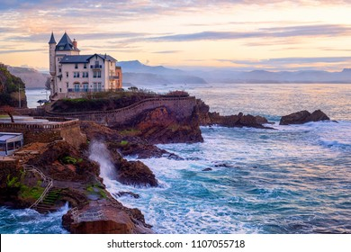 Biarritz, France, Bay of Biscay, the rocky Basque coast of Atlantic ocean in dramatic sunset light
