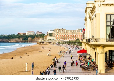 Biarritz, France - October 3nd. 2014 - Tourists enjoying a late sunset in the beach of Biarritz in France in Europe.