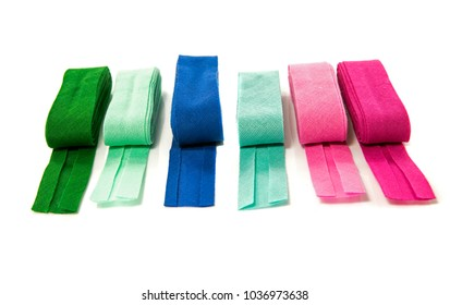 bias binding in blue green and purple isolated on white with text space