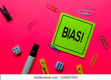 Bias! write on sticky notes isolated on Pink background.