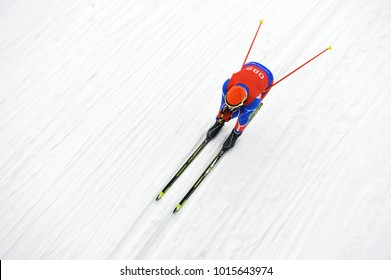 biathlete skier coming down the slope during the competition