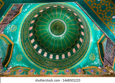 Bibi-Heybat, Baku, Azerbaijan - May 12, 2019. Interior view of the dome ceiling of Bibi-Heybat mosque in Baku, decorated with green and turquoise mosaics and gilded inscriptions from Qur'an.