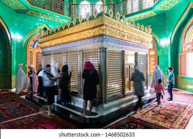 Bibi-Heybat, Baku, Azerbaijan - May 12, 2019. Tomb of Ukeyma Khanum, a descendant of prophet Muhammad, inside the Bibi-Heybat mosque in Baku, with blurred figures of people.