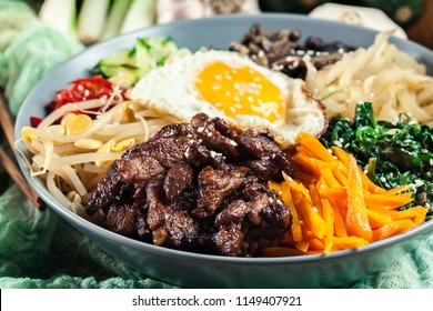 Bibimbap - rice with beef and vegetables. Traditional Korean dish.