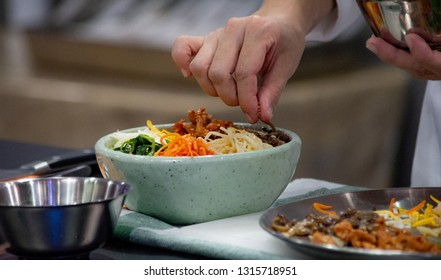 Bibimbap, Traditional Korean cuisine bibimbap, Chef preparing Korean food, chef cooking in kitchen