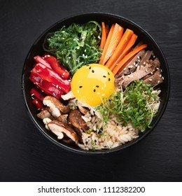 Bibimbap - traditional Korean dish with rice, vegetables, beef