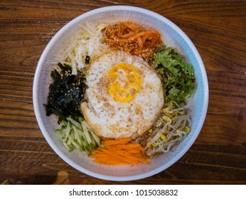 Bibimbap-Korean food, Bibimbap is a classic Korean meal. A bowl of rice is topped with seasoned vegetables, meat and a sunny side up fried egg on top.