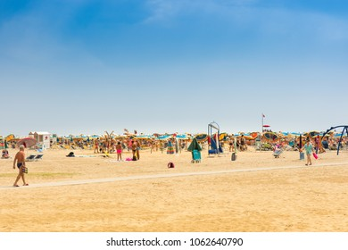 Bibione, Italy - 08/11/2017: A beach full of unidentified tourists in the high season.  The beach is considered one of the most beautiful in Europe