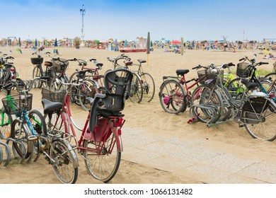 Bibione, Italy - 08/11/2017: Bikes are the most popular way of tourists moving in this seaside town. Bicycle parking at the beach.