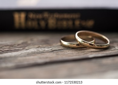 the bible is the base where upon two wedding rings rest. Wedding symbols, attributes. Holiday, celebration.