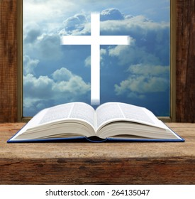 Bible christian cross stormy sky view window open wood