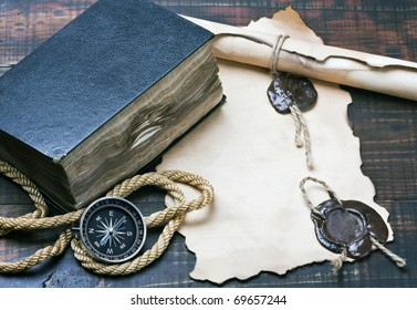 The Bible and compass on old paper