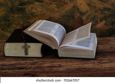 Bible and a crucifix on an old oak table. Beautiful background.Religion concept.