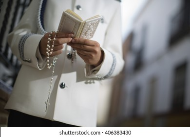 Bible in hands of church alter boy, selective focus. the first holy communion
