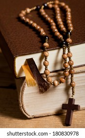 bible and old wooden rosary