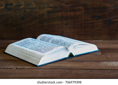 Bible on a brown wooden table. Beautiful background.Religion concept