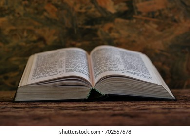 Bible on an old oak table. Beautiful background.Religion concept.
