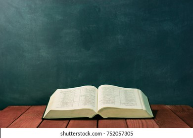 Bible on an red wood table. Beautiful background.Religion concept.