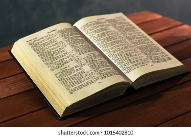 Bible on a red wooden table. Beautiful background.Religion concept