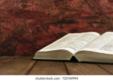 Bible on a wooden brown table. Beautiful background.Religion concept.
