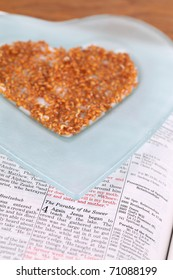 Bible open to Mark 4 with focus on the Parable of the Sower and a heart shaped plate with cress sprouts