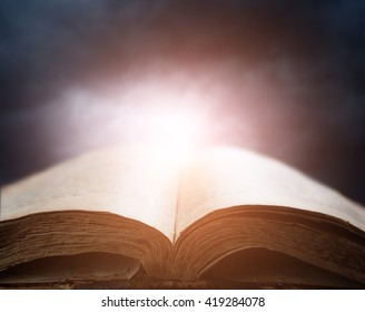 bible over sunset sky