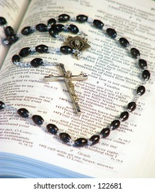 Bible and Rosary close up