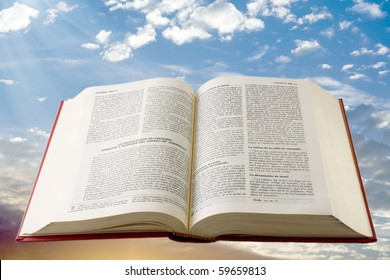 Bible in spanish floating in sky background