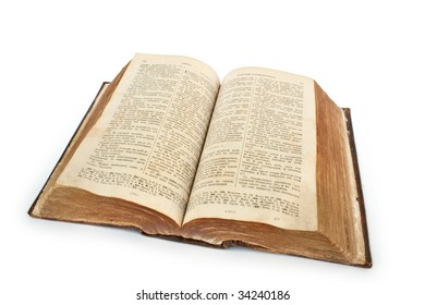 Bible. Very old open book isolated on white