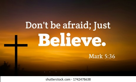 Bible words about dont be afraid just believe with jesus cross and dark evening background