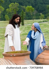 Biblical scene play of the miracle of transformation of water into wine - Mary saying to Jesus there is no wine left