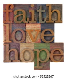 biblical, spiritual  or metaphysical reminder - faith, hope and love in old wooden letterpress type blocks, stained by colorful inks, isolated on white