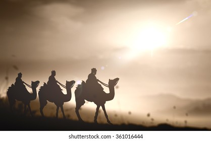 Biblical story concept: Prophecy magi and his friend with three camel on desert was going to bethlehem city in christmas eve