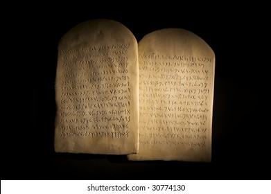 Biblical Ten Commandments inscribed on stone tablets in the Paleo-hebrew script