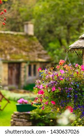 BIBURY, ENGLAND, UK - SEPTEMBER 21, 2014: Traditional Cotswold cottages in Gloucestershire on September 21, 2014, England. Bibury it the most depicted village in the world.