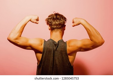 Biceps concept. Athlete show biceps and triceps, back view. Man flex arms with biceps. Biceps muscle of arms.